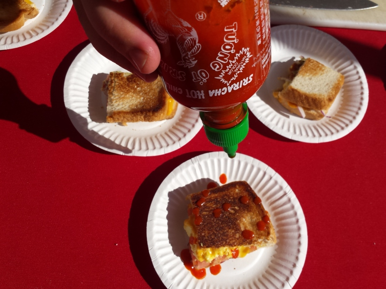 Extra sriracha on that Greenspans Grilled Cheese, please!